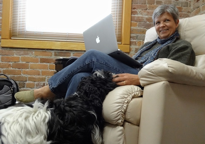 People_-_Advertising_director_Jennifer_Del_Carlo_works_with_her_dog_Maisie_at_her_feet.jpg