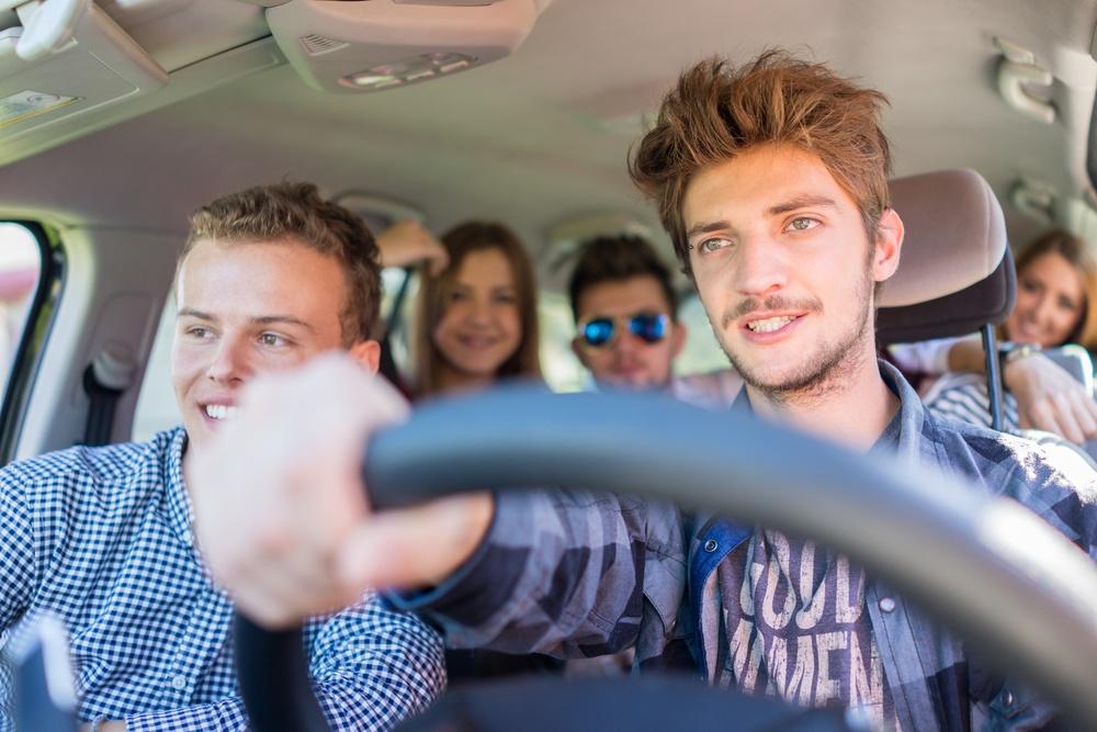 Young people having vacation enjoying fun driving car.jpeg