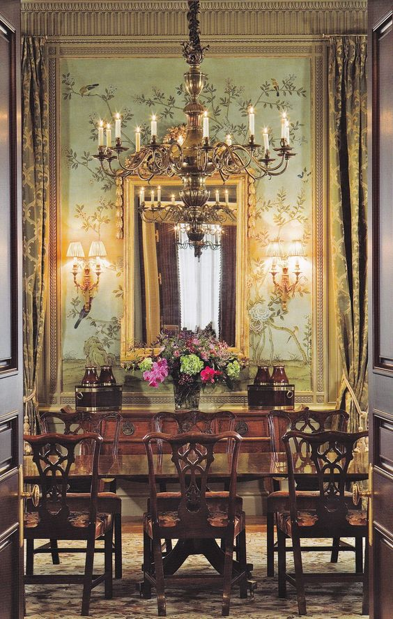 An Aubusson rug is a wonderful complement for Chippendale dining chairs and Chinoiserie wallcovering.