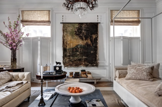 An Aubusson rug in muted gold colors allows you to mix contemporary furniture and traditional art as in this living room.