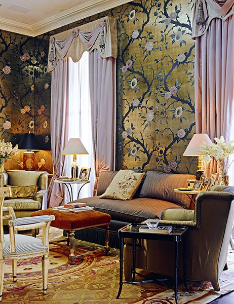 An Aubusson rug with golds, reds and a ornate medallion pattern is wonderful for pulling together rich fabrics while creating a modern vibe as in this drawing room designed by Nicky Haslam.