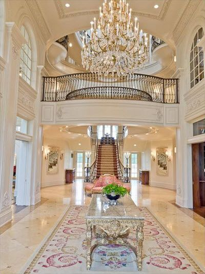 Aubusson rugs are often used to create a grand look as in the hallway of this palatial California home.