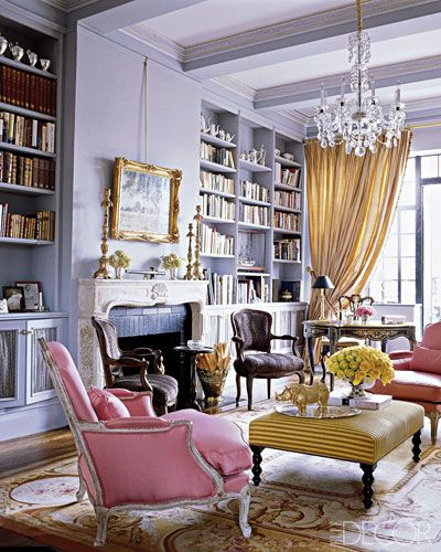 A cream and gold Aubusson rug provides a great setting for lavender walls and pink and gold upholstery.