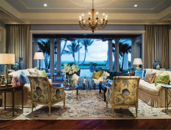 cream, blue, yellow and green floral needlepoint rug enlivens a seaside Palm Beach living room by Marc-Michaels Interior Design