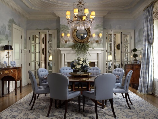 A cream and blue floral rug brings elegance to traditional dining room by Scott Snyder