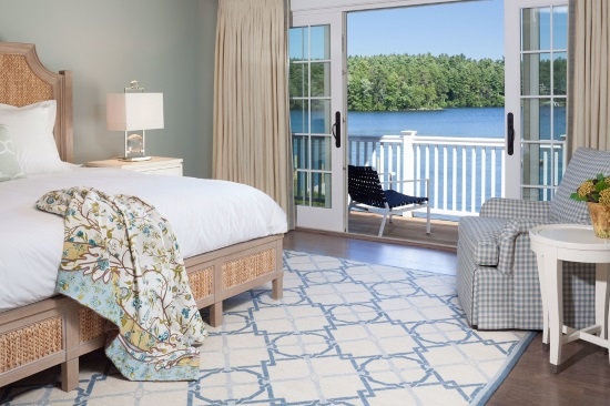 blue and white geometric needlepoint rug adds modern vibe and elegant lakeside bedroom by Cebula Design