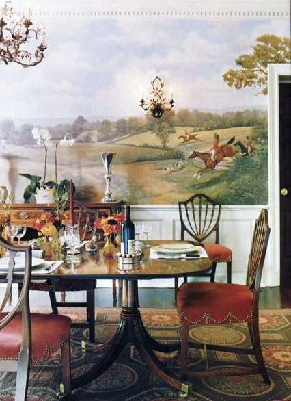 neoclassical needlepoint rug with green, gold and coral red makes great foundation for Downton Abbey and Federal style dining room designed by Bunny Williams