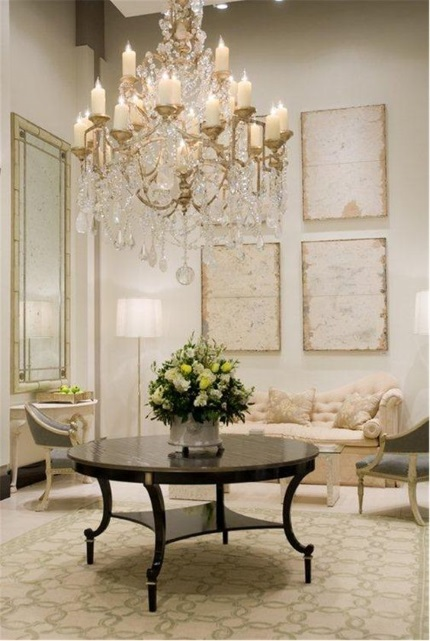 cream and green geometric needlepoint rug allows brings calm and refinement to elegant living room with fine antiques and crystal chandelier designed by Frank Babb Randolph