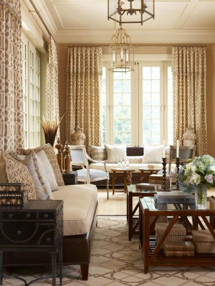 beige and brown geometric needlepoint rug in elegant sun room by Greenwich desginer Cindy Rinfret