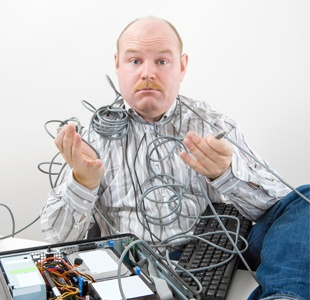 photodune-18523863-confused-businessman-holding-tangled-cables-of-computer-at-desk-l-resized.jpg