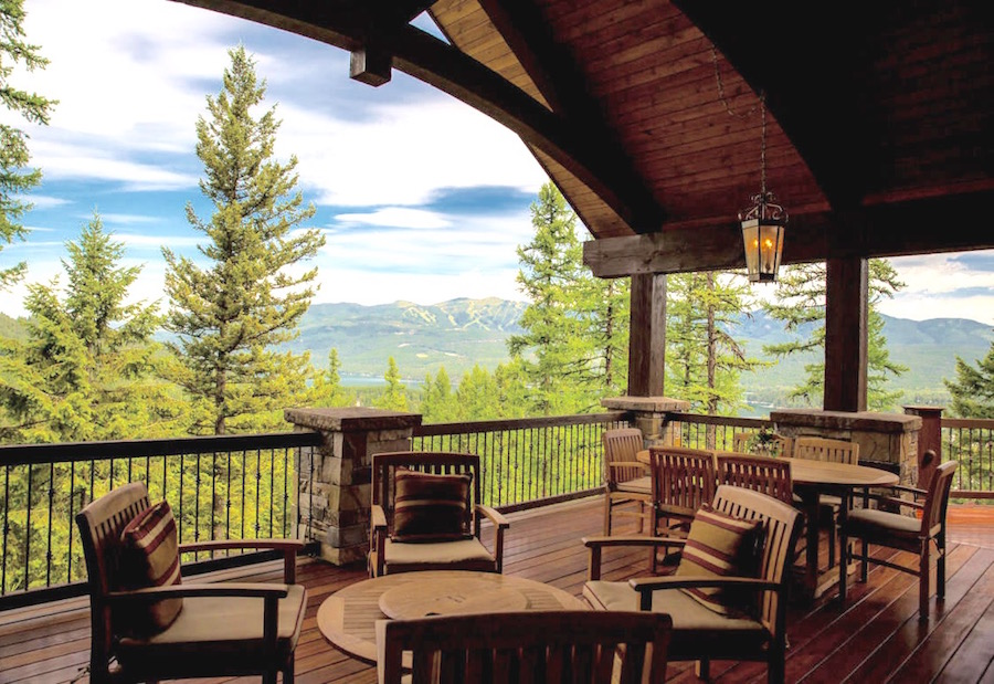 Treetop views and mountain air will whet any appetite, and this grand cabin  offers plenty of both.