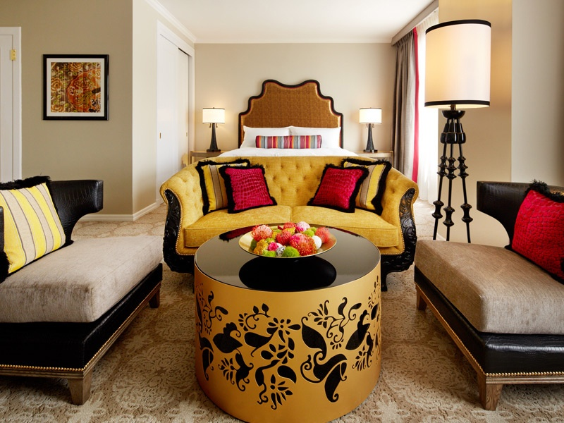 Imperial yellow, gold, black, and fuchsia drive the design of the Scarlet Huntington hotel's Premium rooms. A heritage-inspired Peranakan print is the focal point.