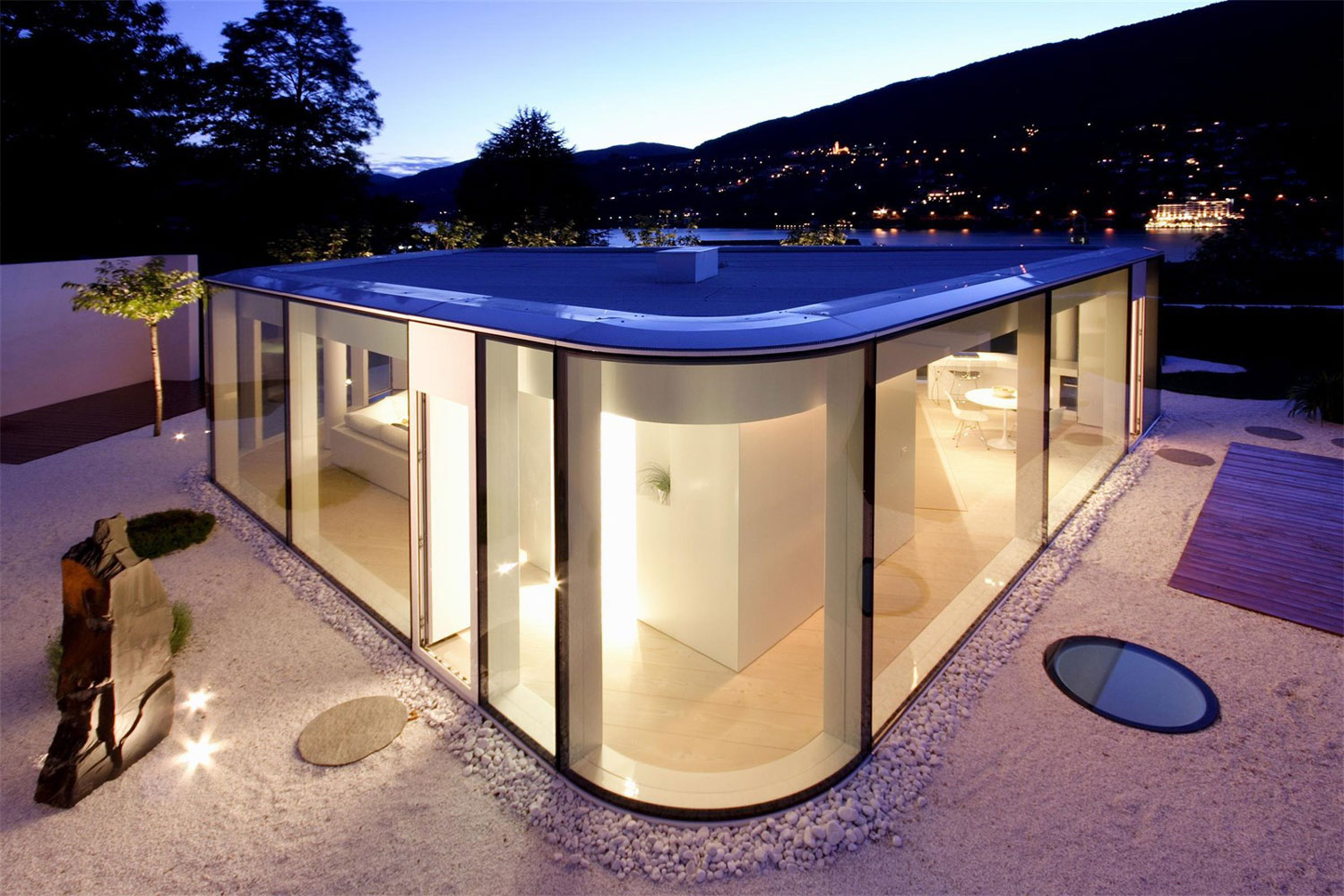 This villa is enveloped in glass to take full advantage of its location on Lake Lugano with state-of-the-art materials, luxurious finishes, and designer furniture..