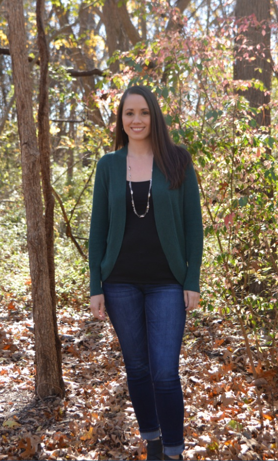 Jennifer Tate posing for a photo in the woods.