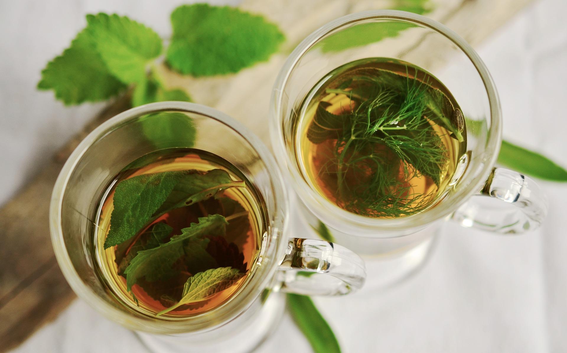 Herbal Tea With Floating Leaves