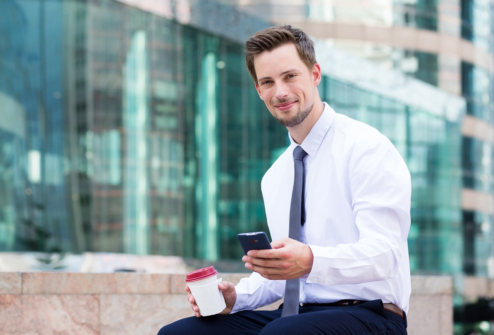 Businessman outside using cell phone