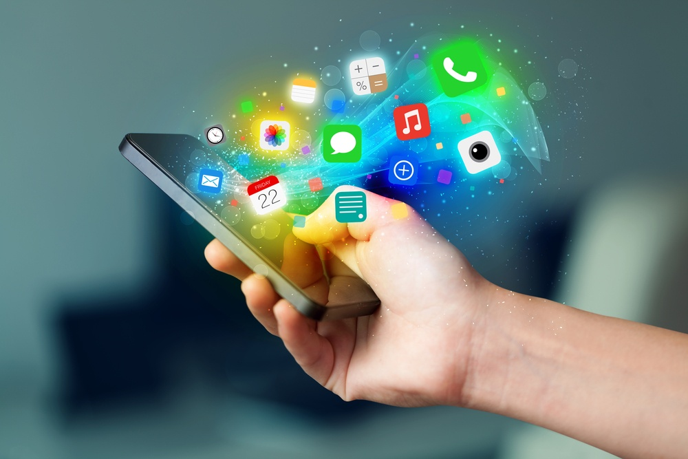 Hand holding smartphone with colorful app icons concept.jpeg
