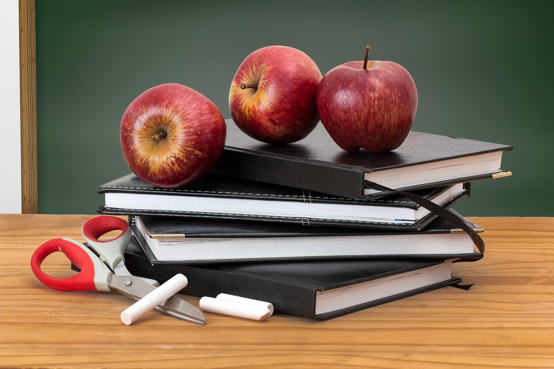 Apples on books