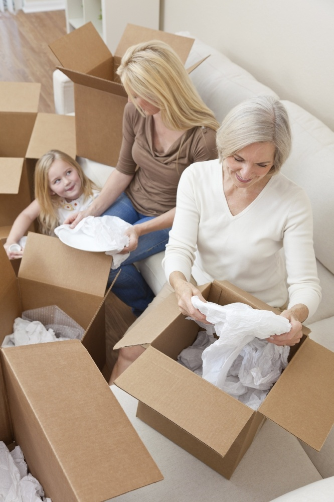 3-Generations-Women-Packing-Boxes
