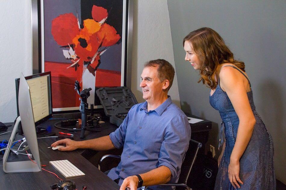 Man and Woman looking at desktop