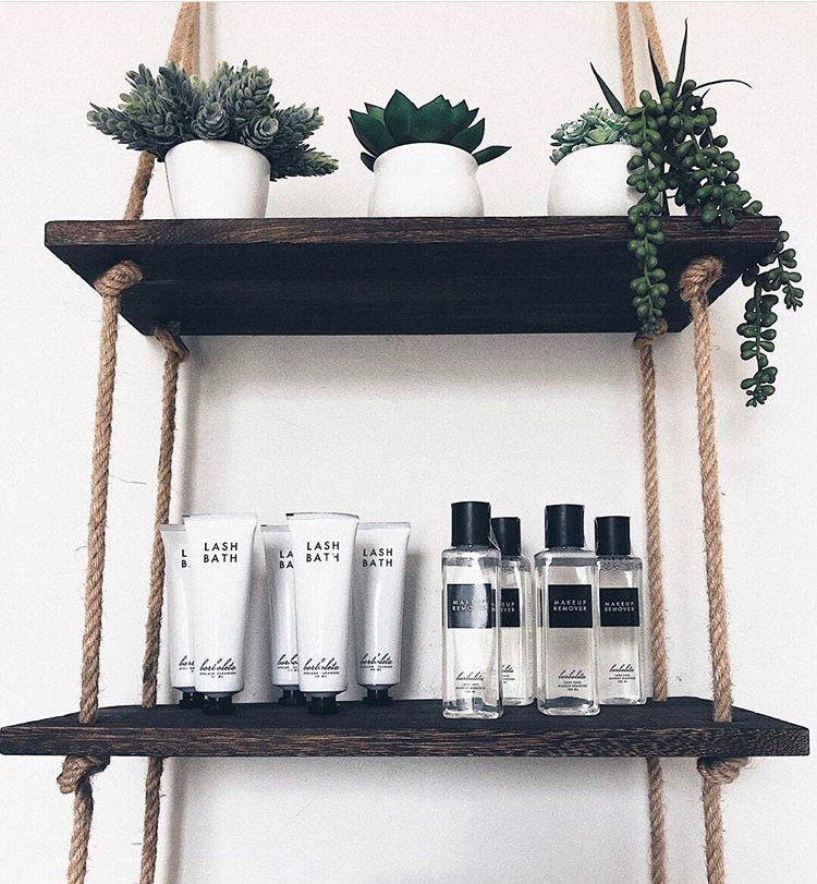 lash studio aftercare products setup on rope shelves with Lash Bath and Makeup Remover by Borboleta Beauty
