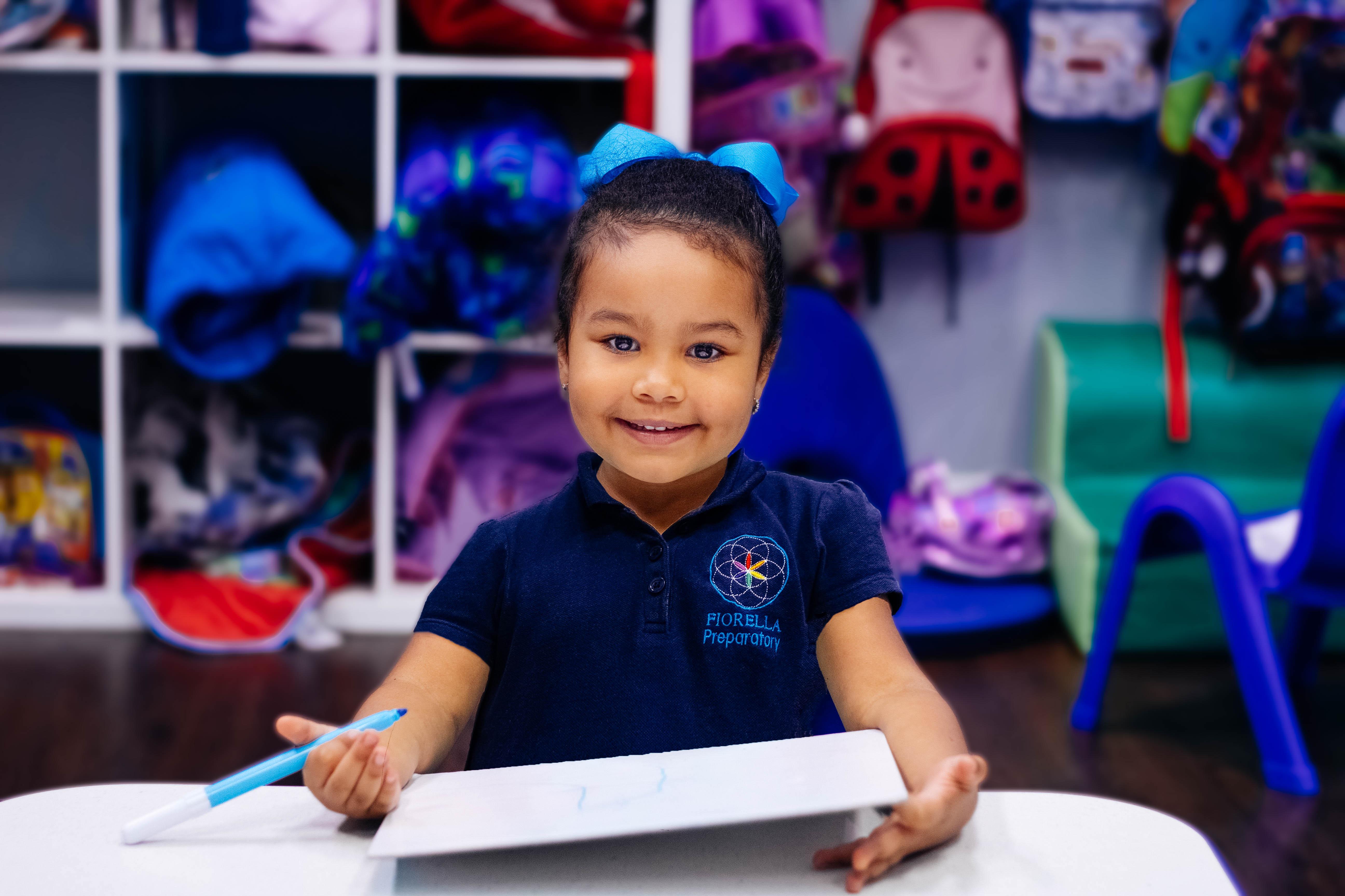 Preschool girl smiling and holding marker-2