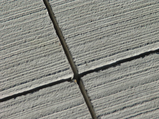 broomed concrete is a popular finish for commercial hardscaping with concrete