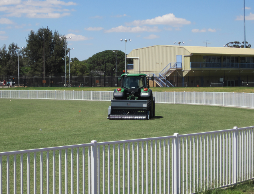 lawn aeration helps enhance commercial turfgrass