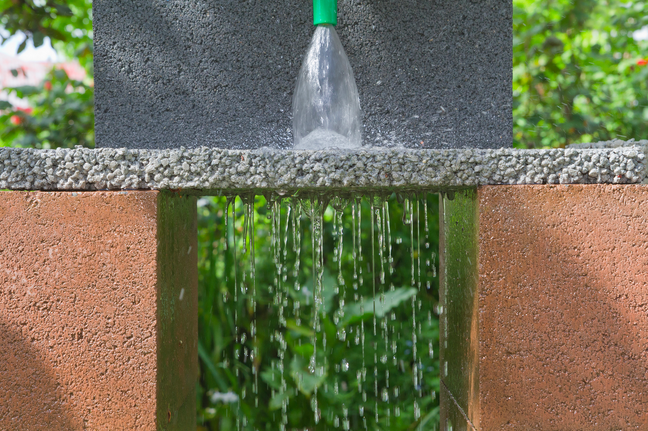 Permeable pavement allows for the percolation of stormwater to drain through porous pavers to a stone reservoir underneath.