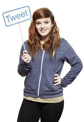 Teenage girl holding Twitter sign