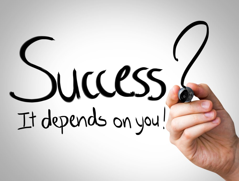 """Success, it depends on you"" Hand writing with black marker on transparent wipe board"