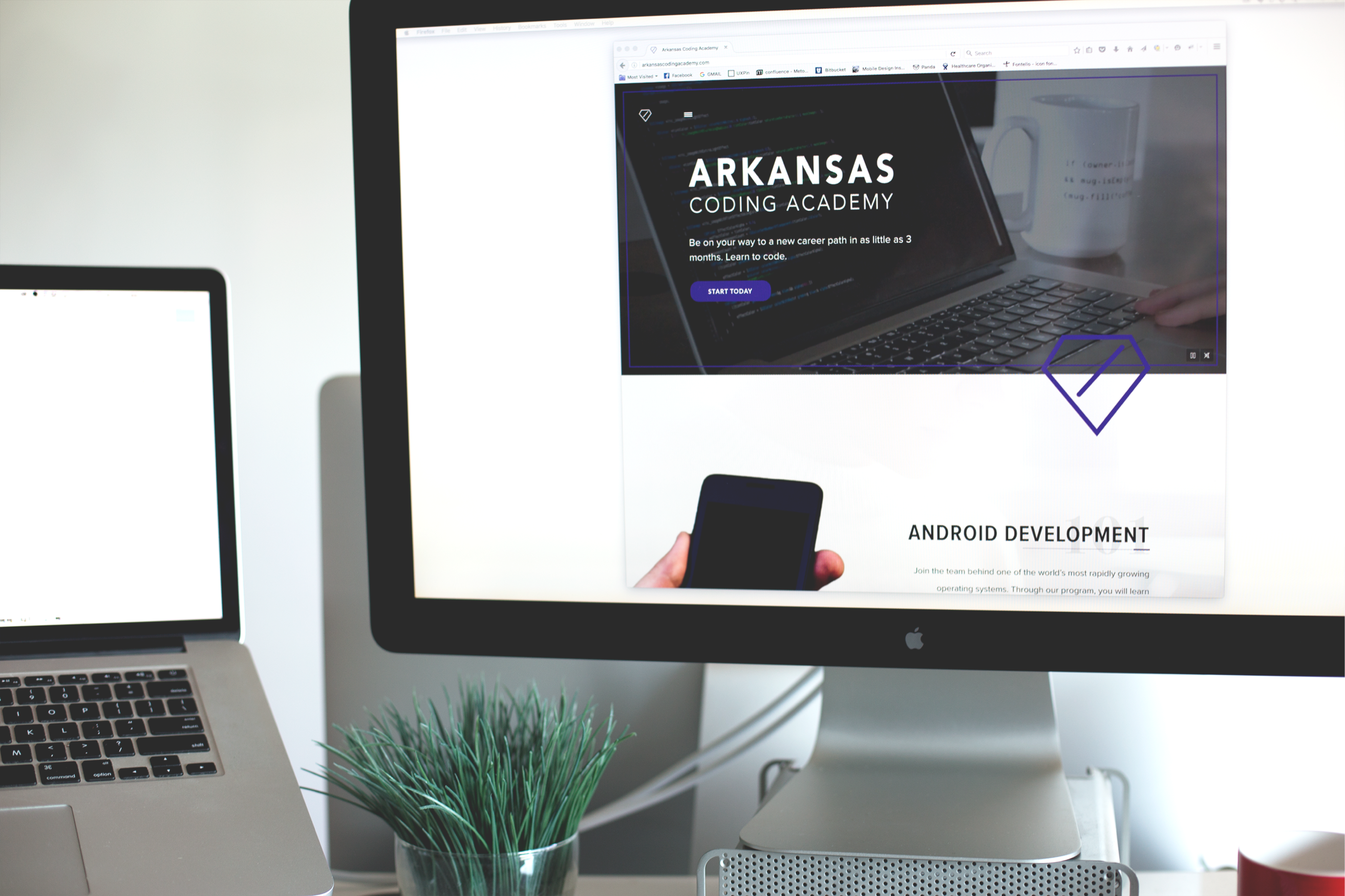 arkansas coding academy website on a computer