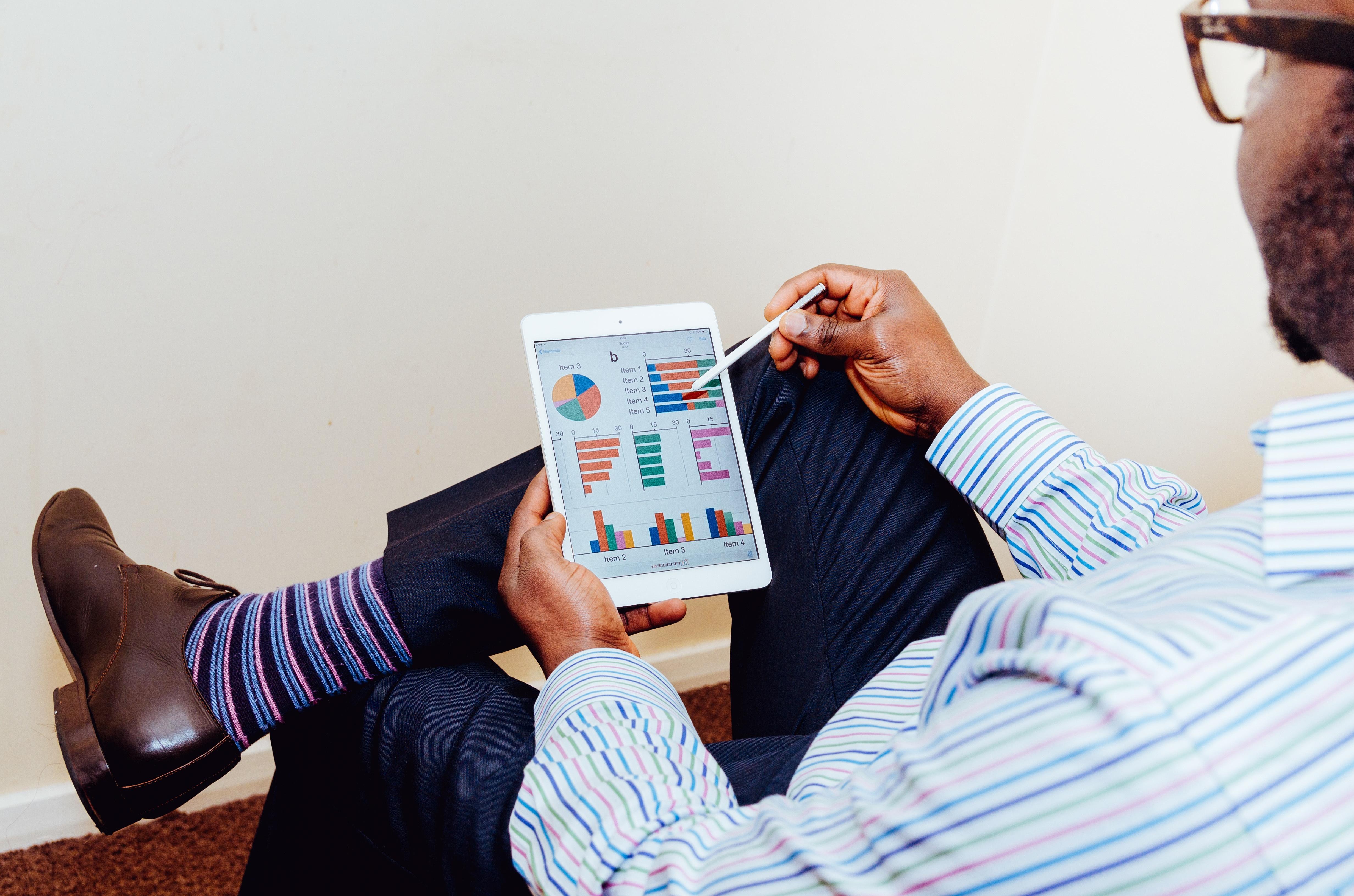 Man reviewing charts on an ipad