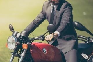 broker_on_motorcycle-432428-edited-1-1