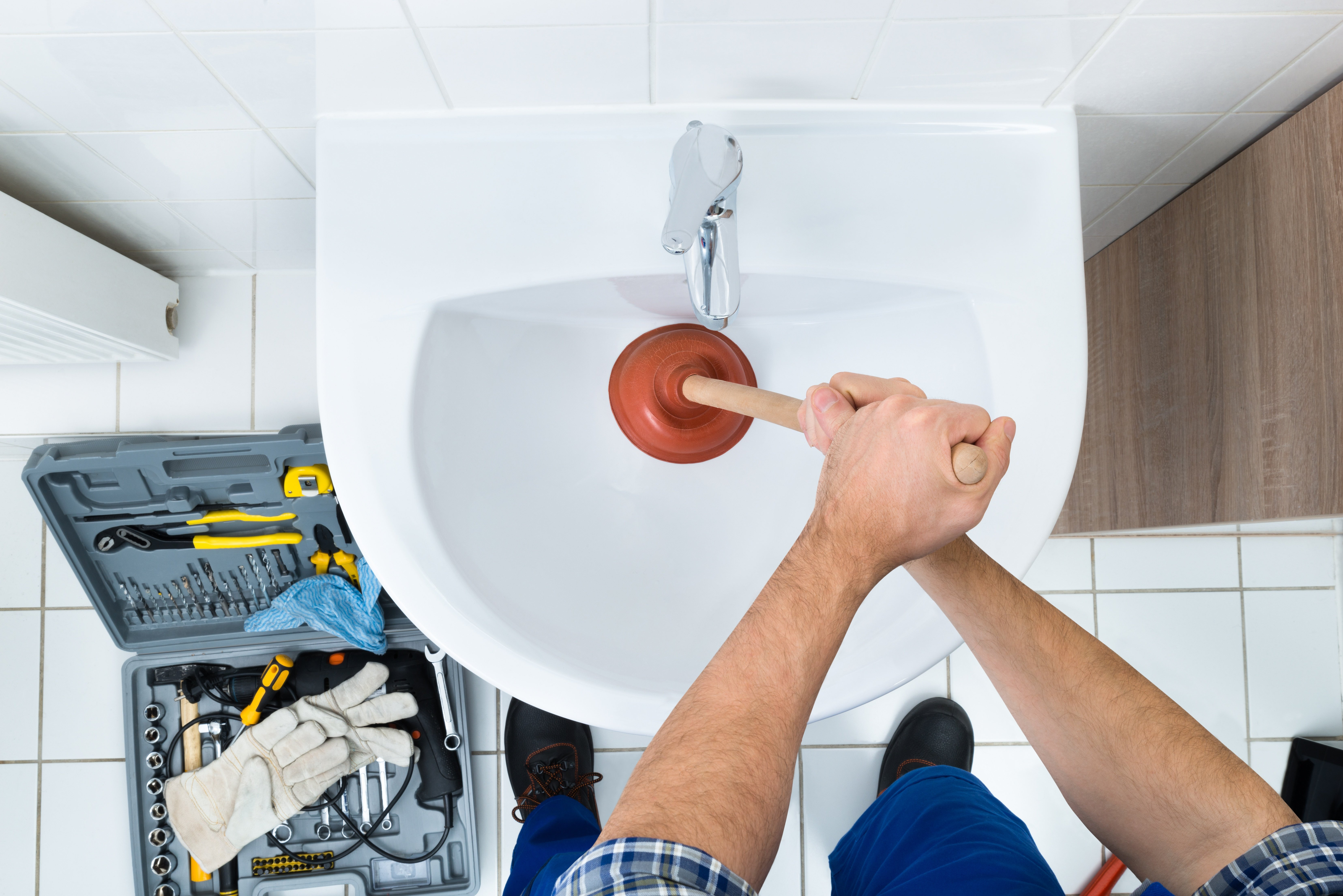 Plunger in toilet - how to unclog a toilet