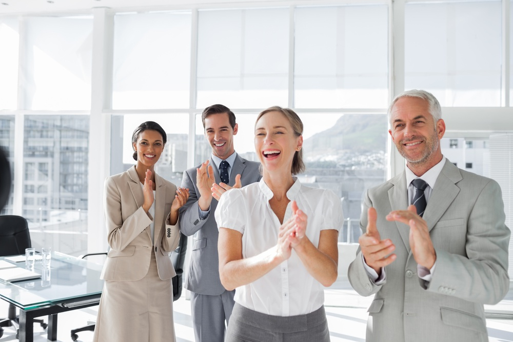 Group of business people applauding together in the meeting room-1