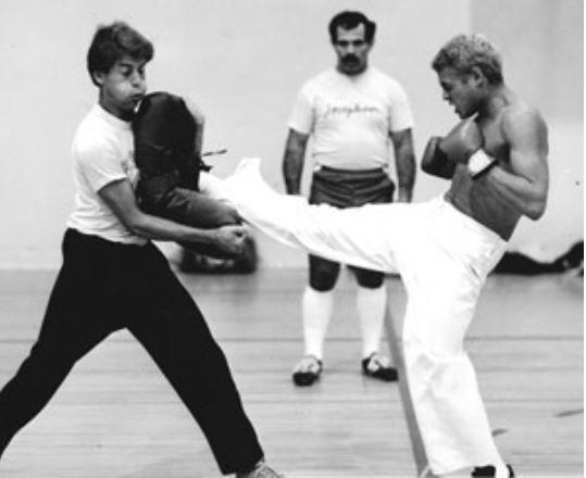 Pat Johnson teaching tang soo do front kicks to two students.