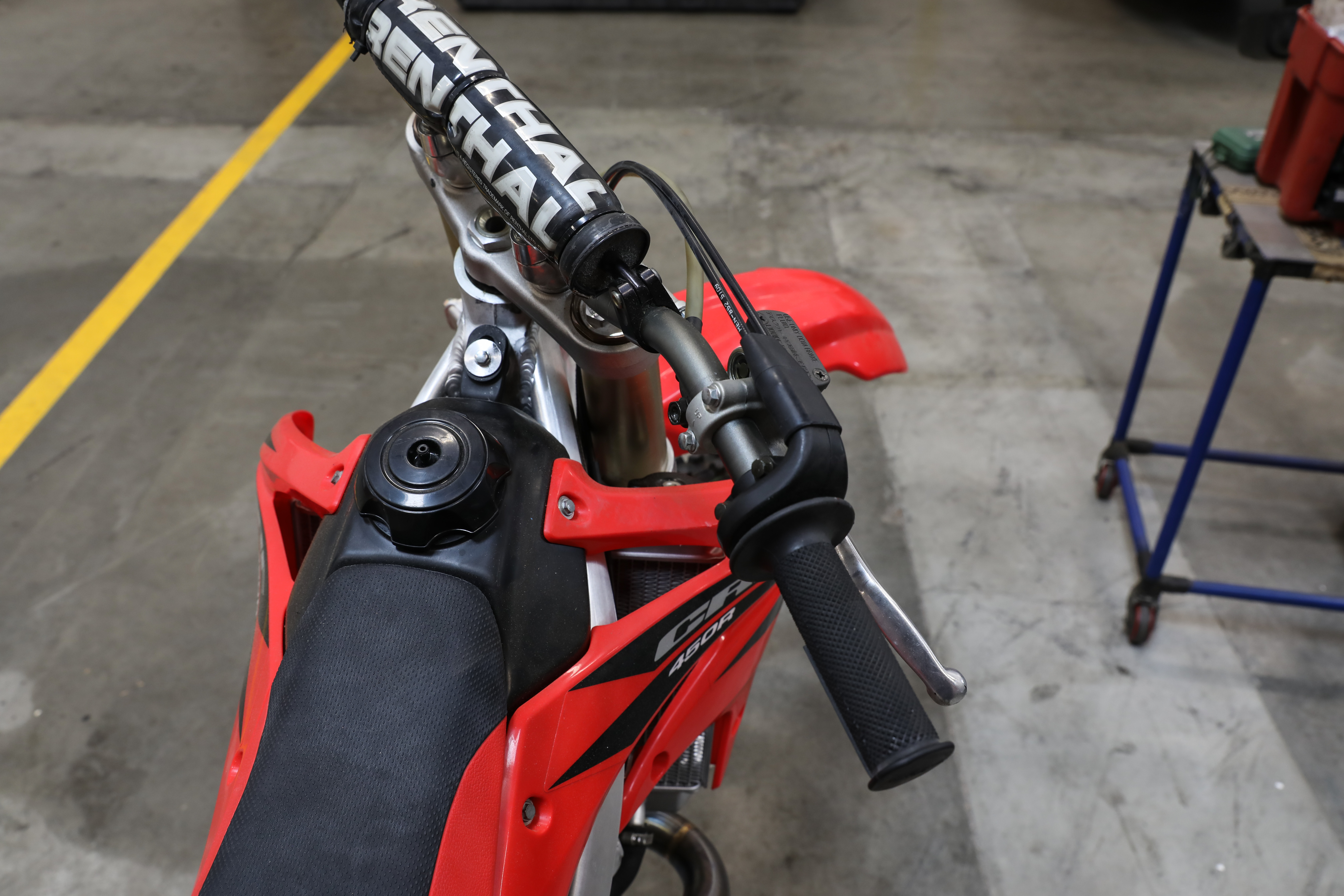 8c1b3acd3a3 With the bike OFF, twist the trottle open to the stop and let go. Make sure  the throttle returns to the closed position quickly and easily.
