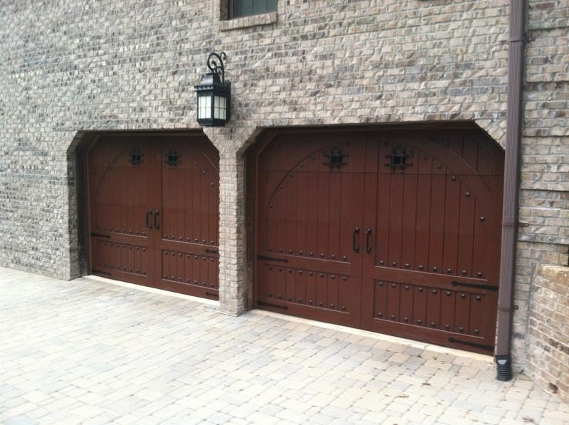 Speakeasy Window Grilles Gives Your Door A Medieval Look & Decorative Hardware Makes Your Garage Door Pop
