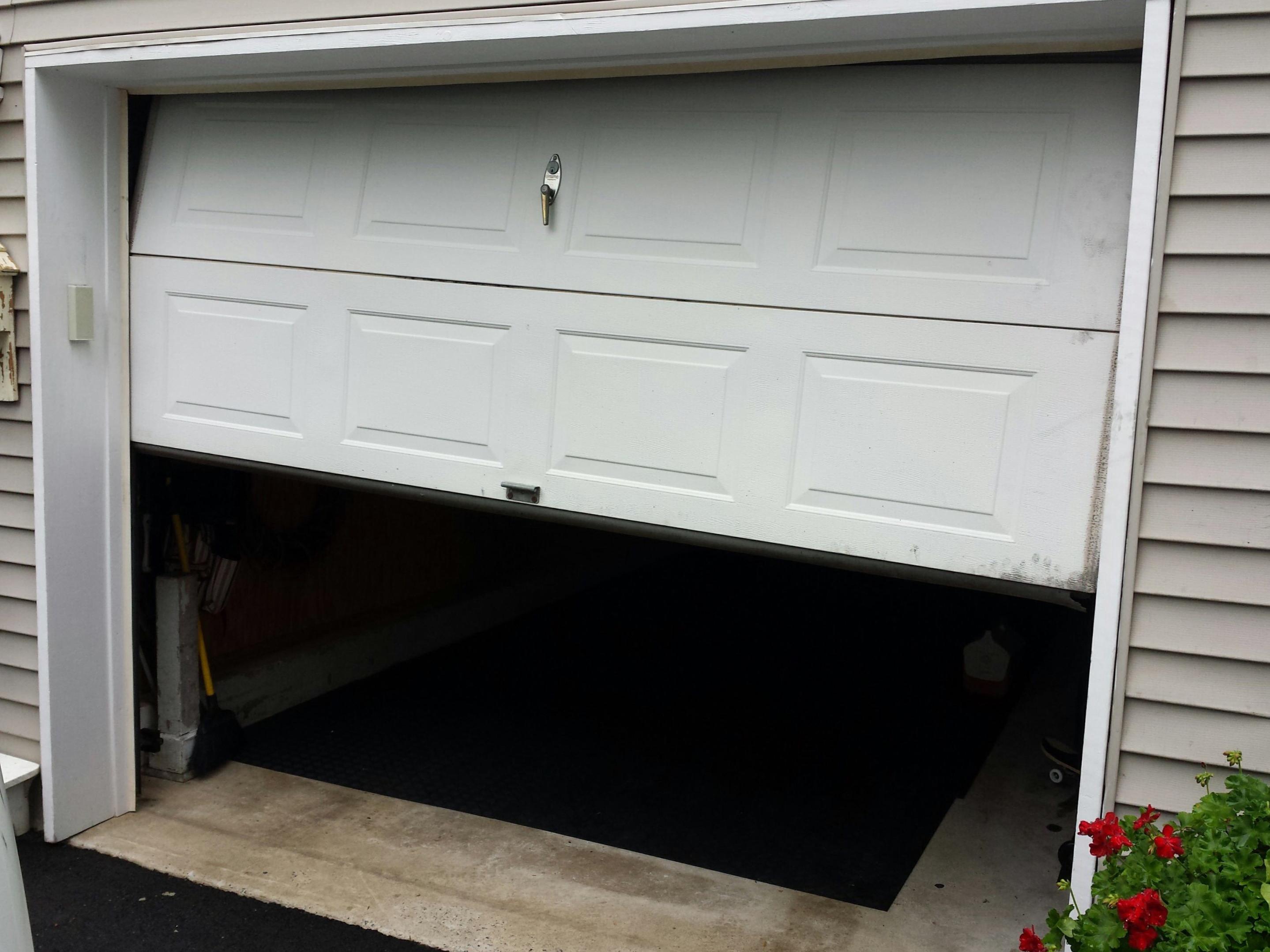 Improperly Balanced Door & 4 Reasons Why Your Garage Door Is Squeaking