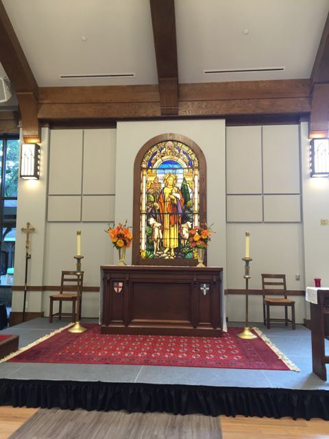 Back lit stain glass with altar