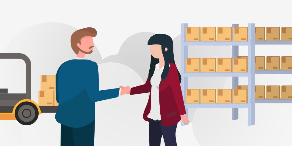 Hombre y mujer acordando la importancia del control de inventarios.
