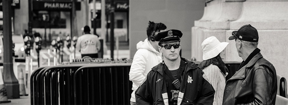 Police officer on duty outside at a special event.