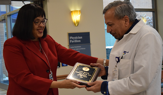 Photo of Dr. Hayek accepting the award from Cynthia Moore-Hardy.