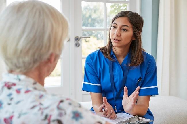 senior-woman-talking-to-a-nurse