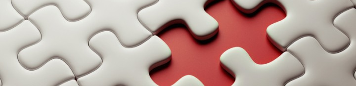 A close up of a jigsaw puzzle with a missing piece, representing overlooked cyber threats.