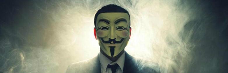 A hacker wearing a Guy Fawkes mask.