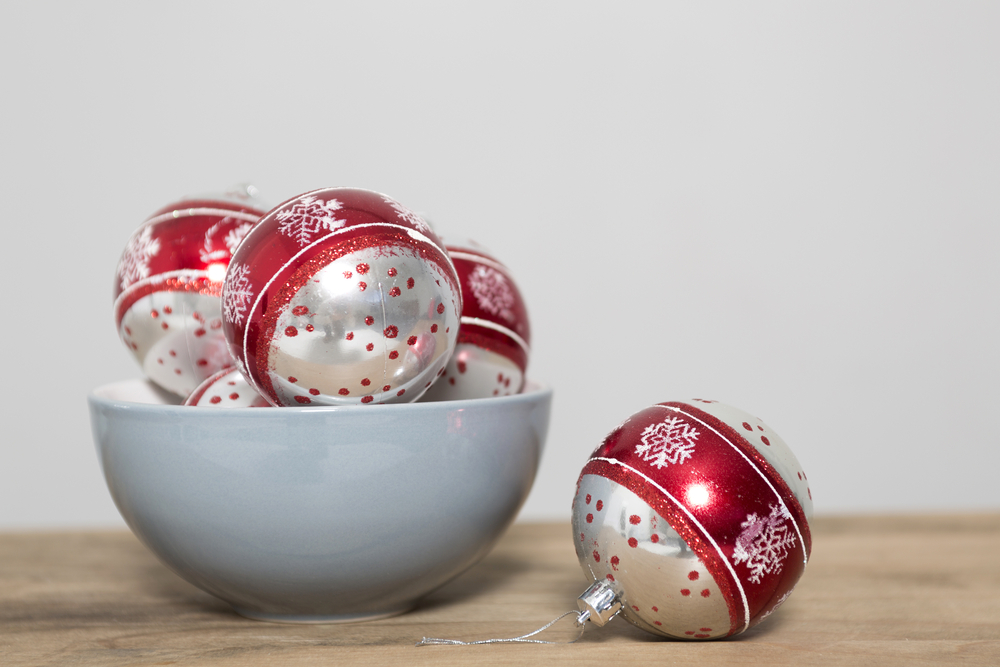 Christmas bauble decorations in a blue bowl on a kitchen table