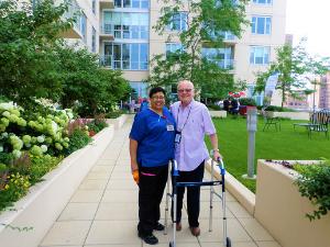 A man and his assisted living nurse at The Admiral at the Lake