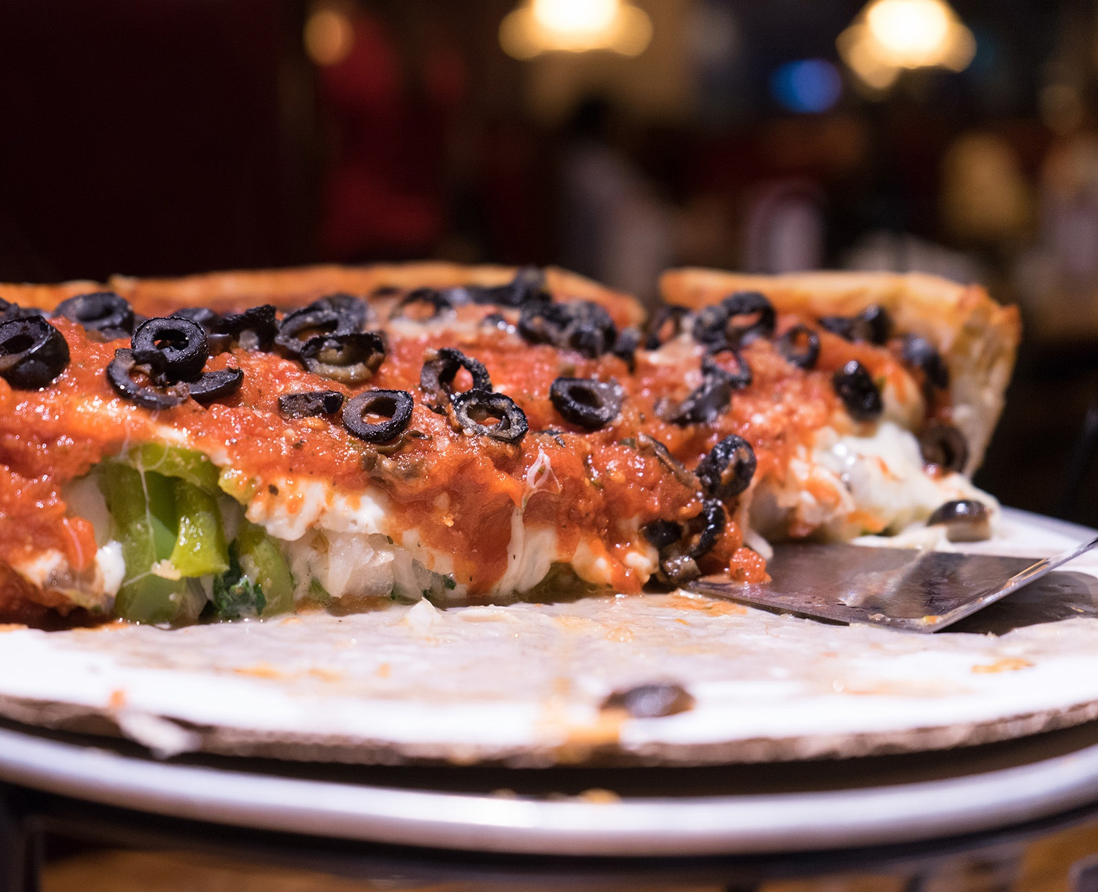 cheesy Chicago style deep dish pizza with olive toppings
